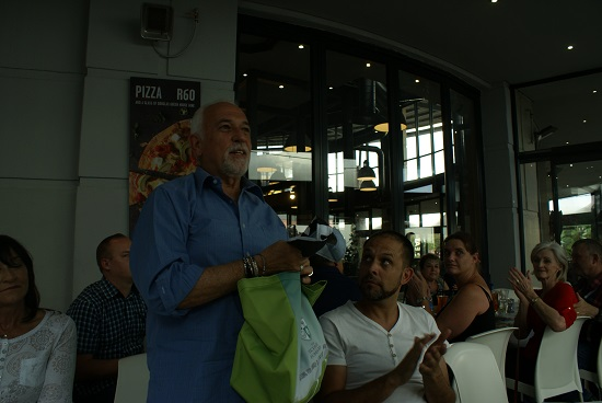 The Recovery Foundation hands Carl a gift bag